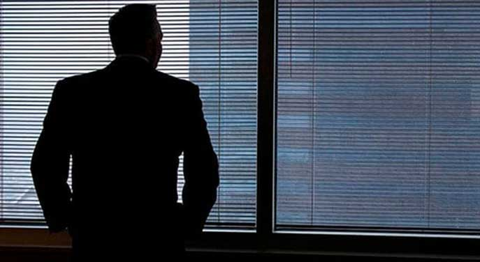Businessman staring out of window