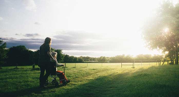 wheelchair caregiver sunset nature sunrise service