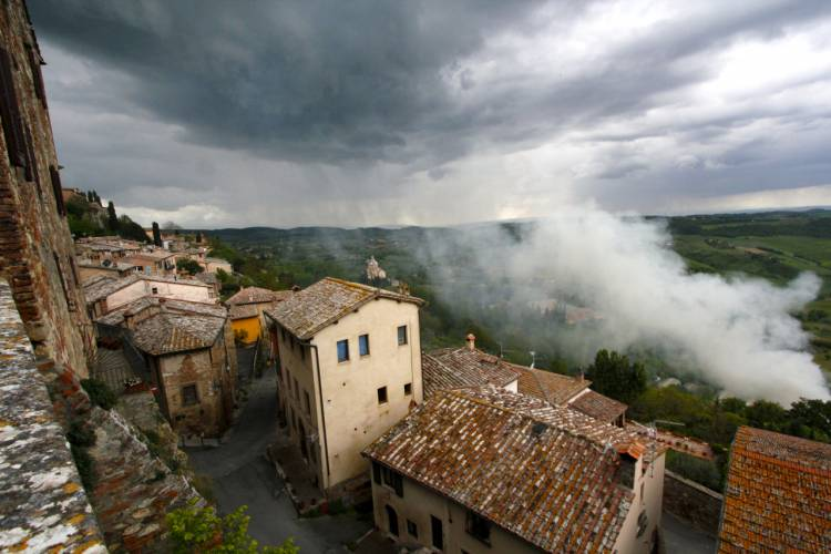 A spring storm meets smoke from burning olive branches in Montalcino