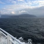 The Orkney Islands loom in the mist off the starboard bow of the MV Stamnavoe